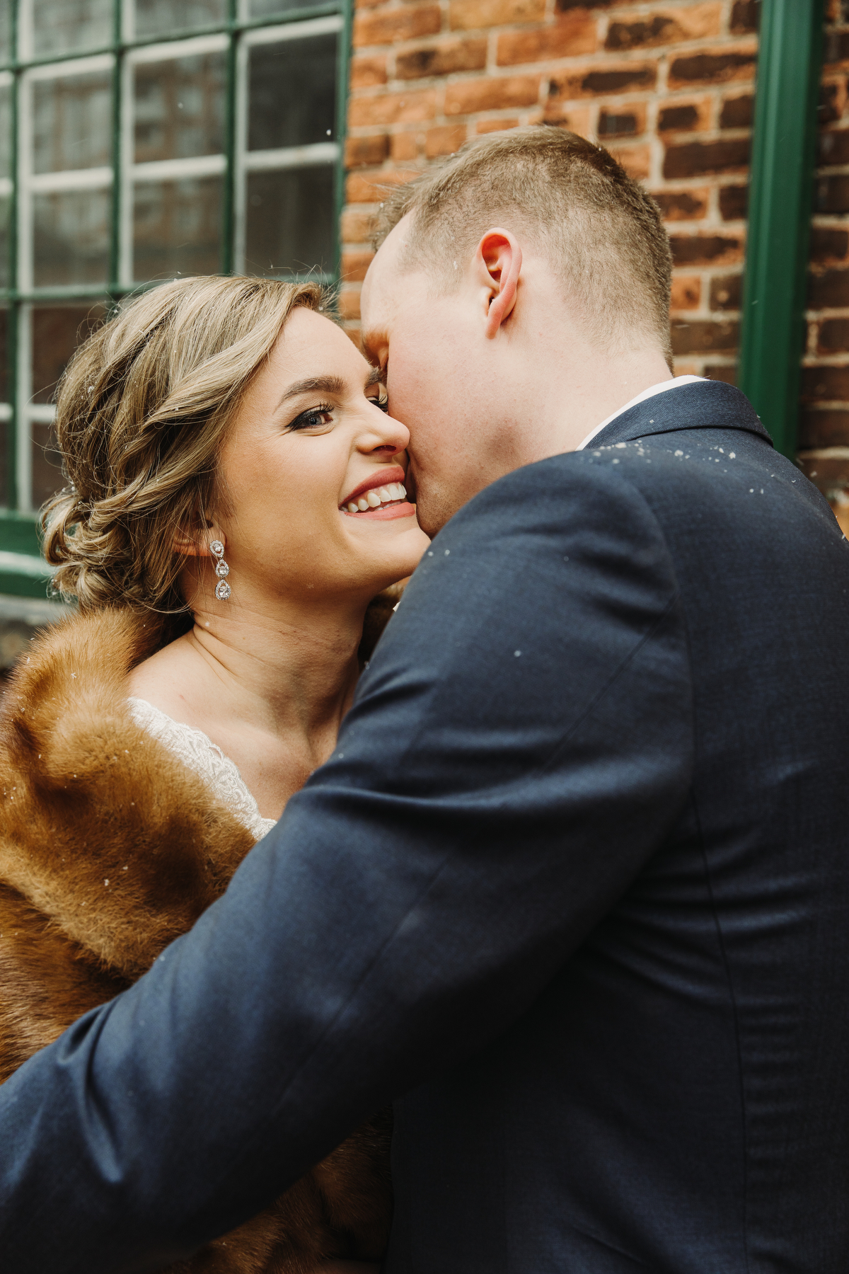couple photos in distillery district toronto by magnolia studios