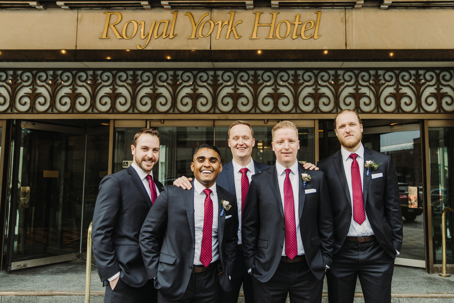 Groomsmen outside of Royal York Hotel downtown Toronto