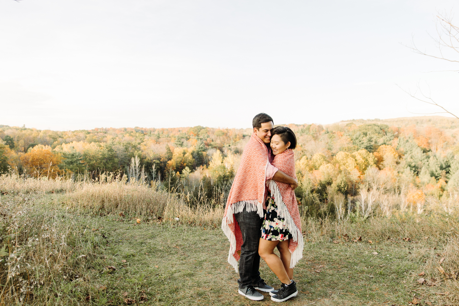 couple cuddling in blanket engagement photography toronto